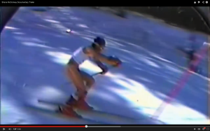 Shane McConkey surprising the audience skiing naked in a slalom race